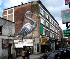 ROA is another artist dear to my heart because of the work he did in London's East End while I was living there, though he's originally from Ghent, Belgium. ROA tends to do paintings of somewhat creepy animals in public places, and, on occasion, does longer installments where he'll paint the bones first and then will paint over them until he has a full painting of the animals. Here are a few he's done: A piece in Hanbury by London's Brick Lane