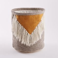 This Liklim ethnic-inspired fringed woven wool basket is great for keeping magazines, toys or decorative items neat and tidy.Liklim fringed basket:Wool with cotton lining.Size of Liklim fringed basket:Size: H40 x Ø35cm