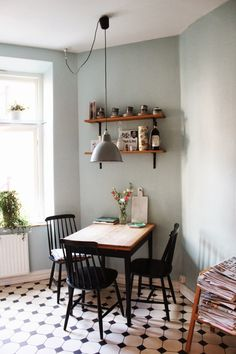 kitchen, dining room, table and chairs, tiled floor, shelves, light shade, vintage, grey