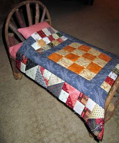 Quilts and a Mug dolly bed with its new quilt