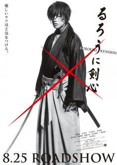 Promotional poster for the live-action Rurouni Kenshin movie starring Takerou Satou as Himura Kenshin.