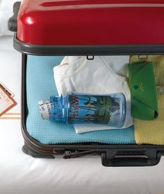 Roll up paper mementos and keep them in a wide mouthed water bottle to prevent damage. >>> Nice travel tip!