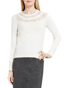 "<ul><li>Solid long sleeve sweater with floral lace yoke</li><li>Jewelneck</li><li>Long sleeves</li><li>Pullover style</li><li>About 24"" from shoulder to hem</li><li>Cotton</li><li>Hand wash</li><li>Imported</li></ul>"