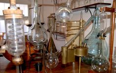 The Sibiu Pharmacy Museum, Romania. A middle room displays a chemist's laboratory, with brass scales, glass retorts and jars, and iron presses ranging from the 15-19th century. The museum's collection comes from old chemist shops, medical institutions, and individuals. Sibiu once had more chemists than any other town in Transylvania; the result is this museum with more than 6,000 pieces.