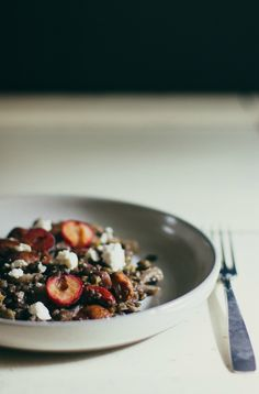 warm lentil salad with cherries, pistachios, and goat cheese