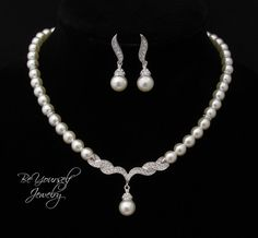 This beautiful pearl jewelry set was made with high quality simulated pearls in the off-white/ivory color. An elegant, feminine and very romantic jewelry set perfect for weddings and special occasions. The necklace measures 16 and comes with a 2 extender. The earrings measure 1 1/4 from the top of the ear wires. This jewelry set is tarnish resistant, white gold plated, Lead free, Nickel free and Cadmium free. The matching bracelet is sold separately here…