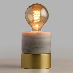One of my favorite discoveries at WorldMarket.com: Marble and Gold Object Desk Lamp
