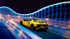 Giallo Orion Lamborghini Aventador SV Roadster on the road at night – December 12, 2015