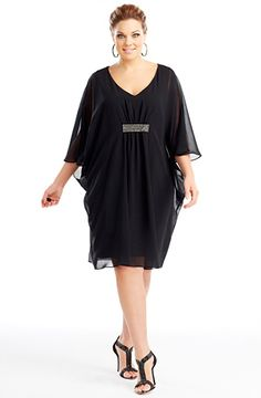 Metallic detail dress/Black Style No: ED5120 Imitation silk knee-length dress. This divine cape dress has a deep V-neckline and features metallic stud detailing centered at the bust. #fashion #plussize #2013