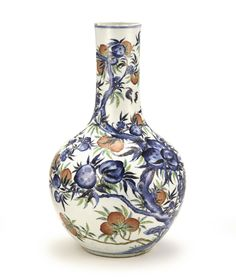 A BLUE AND WHITE AND FAMILLE-ROSE 'PEACH' VASE, QING DYNASTY, 19TH CENTURY of globular form sweeping up to a tubular neck, painted around the exterior in tones of cobalt with a fruiting and flowering peach tree, some branches further extending in famille-rose palette, eight bats hovering around, the smaller leaves highlighted in gilt 44.5 cm