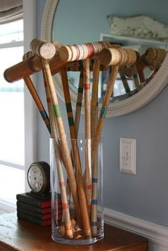 love this idea...croquet mallets.  An vintage bowl with the croquet balls in it next to this could be great as well. (sweet reminder of the games from our wedding!)