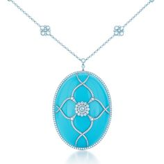 Turquoise of such a deep, even hue and smooth texture is seldom seen. Oval turquoise pendant with diamonds in platinum.