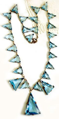 Stunning Art Deco necklace with aquamarine-colored Czech art glass set in sterling silver. Via Diamonds in the Library.