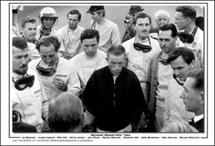 Drivers' meeting, 1964 Belgian Grand Prix: Jo Bonnier, Innes Ireland, Phil Hill, Chris Amon,  Jim Clark, Richie Gunther, Graham Hill, Jack Brabham,  Dan Gurney, and Bruce McLaren.