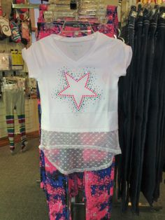 Girls sizes 7 to 16. A cap sleeve hi low design top over a printed cotton and spandex 5 pocket jean.