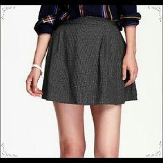 Polka Dot Pleated Mini-Skirt Very cute. Elasticized waistband in back. Textured medium-weight, all-over white polka dot crepe. Sits on waist. Old Navy Skirts Mini