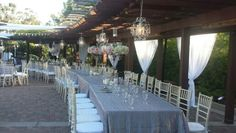 Chiffon draping, and chandeliers over the tables. Rentals by Platinum Event Rentals- venue Japanese Friendship Gardens Balboa Park