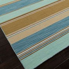 Handcrafted wool flatweave rug with multicolor striping.   Product: RugConstruction Material: 100% WoolColor: Blue and multiFeatures:  ReversibleDurableEasy care Note: Please be aware that actual colors may vary from those shown on your screen. Accent rugs may also not show the entire pattern that the corresponding area rugs have.Cleaning and Care: Vacuum regularly. Blot spills immediately with cold water and mild soap.