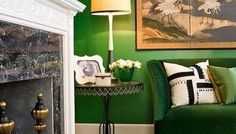 Green walls create a jewel box effect.