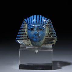 Head of a blue glazed composition shabti with black detail of Sety I. 19th dynasty. Reign of Sety I.   The British Museum
