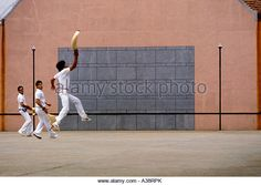 French Basque people person adult men playing pilota pelota jai alai in the French Basque Country in town of Ustaritz France - Stock Image