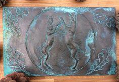 Boxing hares garden sculpture cold cast bronze garden plaque