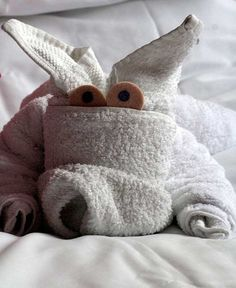 Quirky and cute looking animal origami towel. The funny cartoon eyes help make the animal design look even more adorable and funny. This cute and engaging origami is surely fun to create.