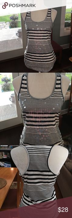 "Almost Famous Sequin Tank Top Black and cream striped racer back style tank top. Sequins adorn the front. Brand new but I took tags off. Chest laying flat 17"". Length 27"" Almost Famous Tops Tank Tops"