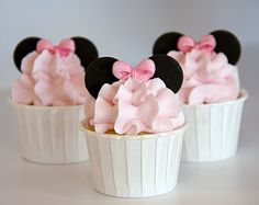 Mini Mouse cupcakes.  -Use mini oreos for ears -Pink Icing -bow candies