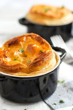 Put a new spin on the classic casserole dinner with these individual mini chicken mushroom pot pies! A quick and creamy filling made from scratch with chicken breasts, sliced mushrooms, milk and butter is hiding underneath a crispy crust with puff pastry. Bake it to golden perfection for the best homemade comfort dinner. This recipe is one of our favorite easy family meals! Click through now to get the printable recipe for these mini chicken and mushroom pot pies!