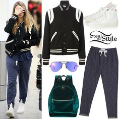 Cara Delevingne was spotted arriving at the Toronto airport a couple of days ago wearing a Saint Laurent Varsity Jacket ($2,390), Native Youth Space Dye Indigo Joggers ($69.00), the Sandro Avril Velvet Backpack ($238.00), Ray-Ban Aviator Violet Mirror Flash Lenses ($170.00) and a pair of Minna Parikka Bunny Calfskin High Top Sneakers ($354.00). You can find similar sunglasses at ASOS ($21.75).
