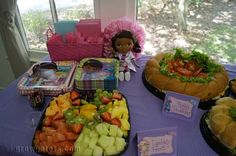 Doc Party food ideas and tent cards. Details on my blog at http://www.growgators.com/2015/03/the-doc-is-in-celebrating-2-with-a-doc-mcstuffins-party/