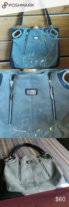 Beijo... bag authentic brand new Only used once perfect condition one little mark on bottom side scuff u can't even see it hardly great steal very classy Bags