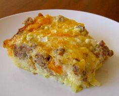 EASY YANKEE SPOILER BREAKFAST CASSEROLE  1 c. hot cooked grits (1 c. water & 3 T. grits)  1 box Jiffy Corn Muffin Mix  4 eggs, beaten  1 3/4 c. hot milk  1 stick butter, melted  Salt & Pepper to taste    Mix above ingredients together & set aside.   1 c. grated cheddar cheese  1 lb. sausage, cooked and drained   Layer sausage, grits mixture & top with cheese.    Bake 45 min. @ 325 degrees