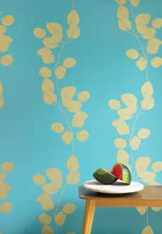 gold leaves on teal.  reminds me of bora bora.  accent cubby in bedroom?  laundry room?