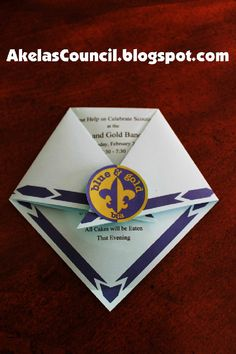 Akela's Council Cub Scout Leader Training: Blue and Gold ideas -- AWESOME invitation idea.  Printable PDF pattern and art, just add your own wording.  Could adapt for programs, too.