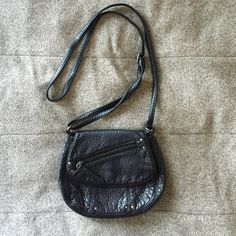"""Black Crossbody Purse Bought from Nordstrom a few years ago but in great condition. This is a little miracle bag that somehow always manages to fit everything you need for a night out. Used this in college and loved it. Can't say enough good things about this purse! Zippered pocket inside and convenient small zippered compartment on outside flap. Magnetic closure. I just don't use small crossbody's anymore. 8"""" wide, 6.75"""" tall, adjustable strap. Nordstrom Bags Crossbody Bags"""