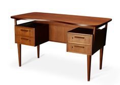 Designer  Danish design  Manufacturer  Danish manufacturer  Materials  Teak  Dimensions  65 x 127 x 72  Price  $1450    A must have for the office of any modernista. A classic Danish teak desk with four drawers and shelving. Comfortable curved top.