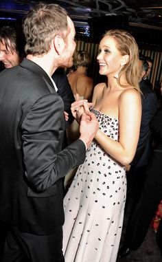 Michael Fassbender was happy to see Jennifer Lawrence at a BAFTA Party in London during February 2013.