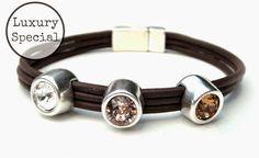 Three in a row - bruin. Leren armband met 3 Swarovski steentjes in mooie naturel kleuren. Sluit met super handige en stevige magneetsluiting. www.milouzzi.nl