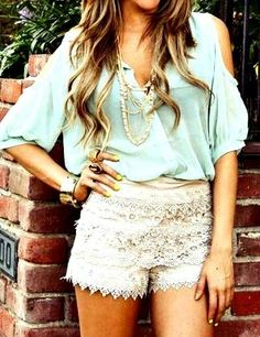 lace shorts, long necklace, and silk blouse
