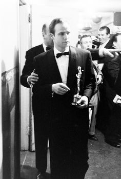 "Marlon Brando backstage at the 27th Academy Awards, after winning his Oscar for ""On The Waterfront"", photo by George Silk, 1955"
