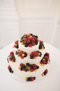 Beautiful cake decorated with lots of fresh fruit!