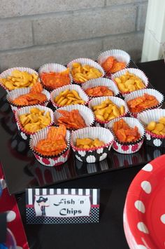 fish and chips snacks for guests on tables...cute idea for Landon's 1st bday