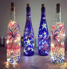 Creative Wine Bottle Crafts With Lights You Want For Your Home Fireworks Wine BottlesFireworks Wine Bottles Empty Wine Bottles, Wine Bottle Art, Painted Wine Bottles, Lighted Wine Bottles, Diy Bottle, Painted Wine Glasses, Bottle Lights, Decorating Wine Bottles, Wine Bottle Lighting