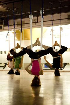"Class Act: AntiGravity Yoga ""Wings"" Want to take my Pilates clients to do this class. Going to make this one of our goals for 2013 :)"