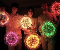 I SOOOO want to make a Sparkleball!!!  Made out of plastic cups and string lights!!!  DIY instructions for eight different sparkleballs here.