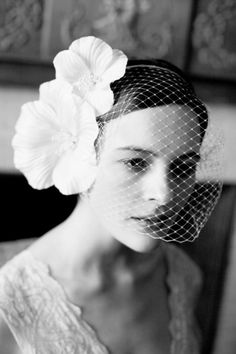 Double Poppy silk flowers with veiling: http://www.stylemepretty.com/lookbook/designer/jennifer-behr/ #SMPLookBook