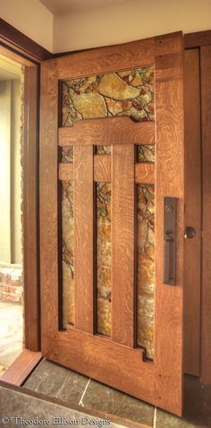 Arts and Crafts style Dunsmuir Door with Fall Leaf Art Glass by Theodore Ellison Designs and The Craftsman Door Company