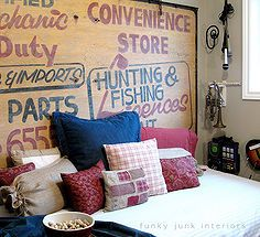 how to create your own headboard from junk, bedroom ideas, crafts, doors, home decor, repurposing upcycling, An old grocer s sign became a whimsical wall element behind a daybed for a playroom Coordinate bedding with the sign graphics and call it done Visit post at
